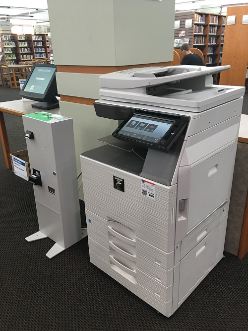 The Library's copy machine and coin box.